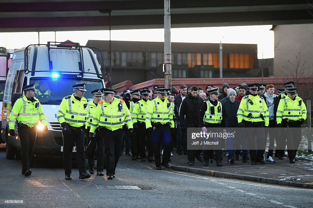 http://media.gettyimages.com/photos/football-supporters-are-escorted-by-police-from-hampden-park-the-picture-id462628508