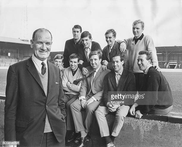 Football talent scout Wally St Pier pictured with a group of West Ham United players whom he discovered early in their careers Geoff Hurst Martin...