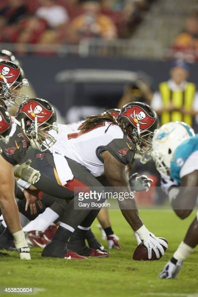 Tampa Bay Buccaneers offensive line at line of scrimmage during preseason game vs Miami Dolphins at Raymond James Stadium Tampa FL CREDIT Gary Bogdon