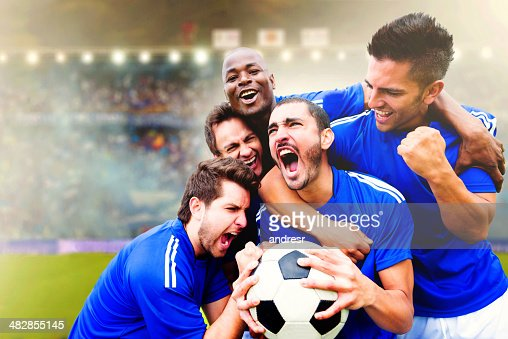 Football team celebrating a goal