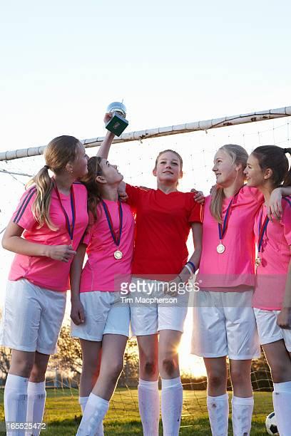Football team cheering in field