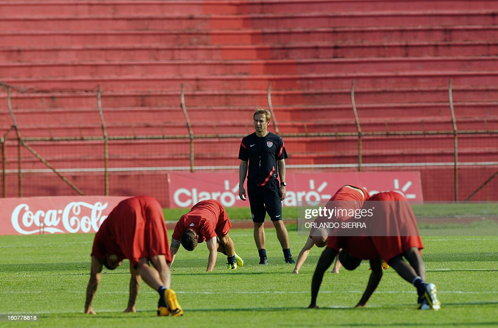 US football team coach Jurgen Klinsmann, looks at his players during a training session at the Olimpico Metropolitano stadium, in San Pedro Sula, 240 km north of Tegucigalpa, on February 5, 2013. The US will face Honduras on Wednesday on a WC2014 Concacaf qualifier football match. AFP PHOTO/Orlando SIERRA