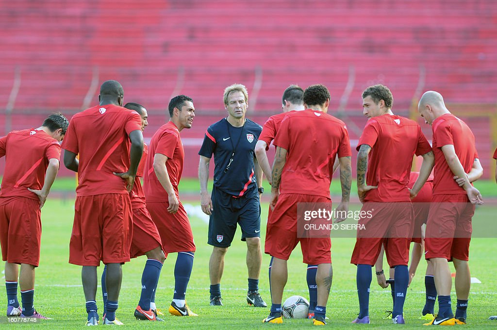 US football team coach Jurgen Klinsmann, speaks to players during a training session at the Olimpico Metropolitano stadium, in San Pedro Sula, 240 km north of Tegucigalpa, on February 5, 2013. The US will face Honduras on Wednesday on a WC2014 Concacaf qualifier football match. AFP PHOTO/Orlando SIERRA