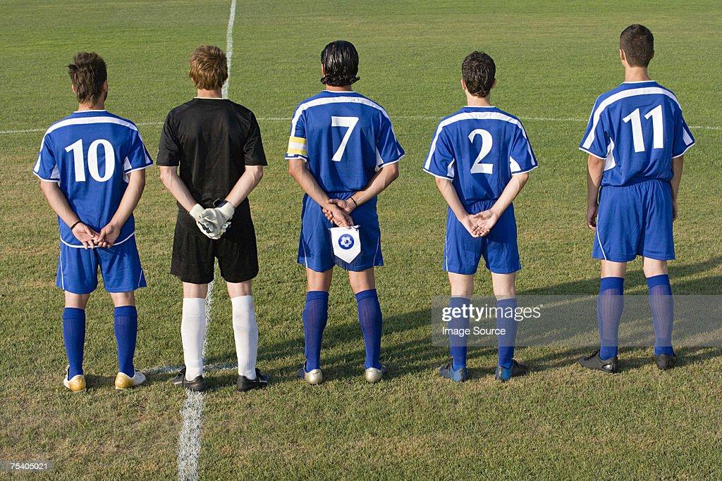 Football team in a row : Stock Photo