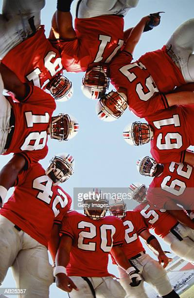 Football team in huddle, low angle view