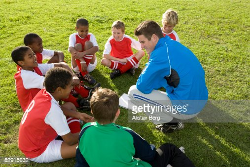 Football team listening to coach : Stock Photo