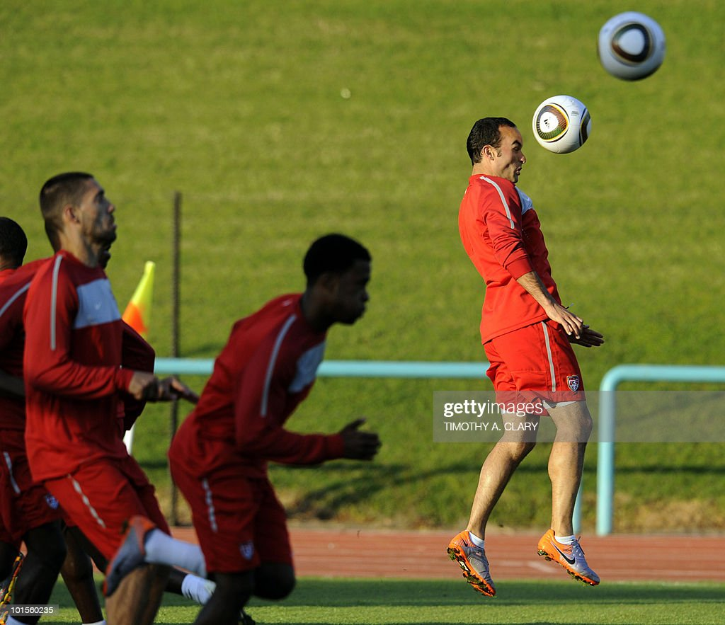 US football team midfielder Landon Donovan (R) heads the ball during a training session at Pilditch Stadium on June 2, 2010 in preparation for the 2010 FIFA World Cup held in South Africa.