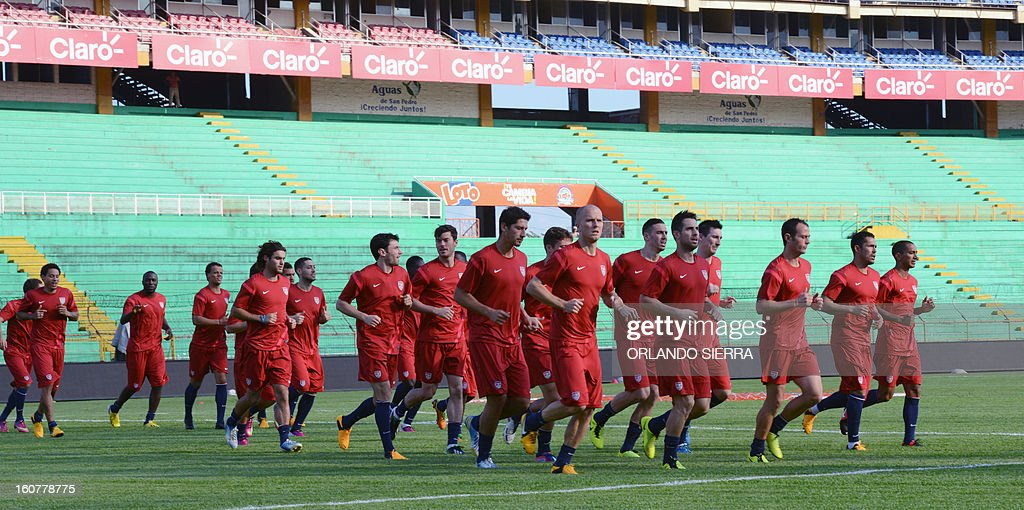 US football team players run during a training session at the Olimpico Metropolitano stadium, in San Pedro Sula, 240 km north of Tegucigalpa, on February 5, 2013. The US will face Honduras on Wednesday on a WC2014 Concacaf qualifier football match. AFP PHOTO/Orlando SIERRA