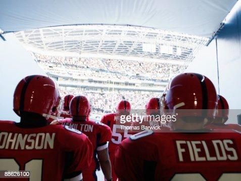 Football team preparing to enter crowded stadium : Stock Photo