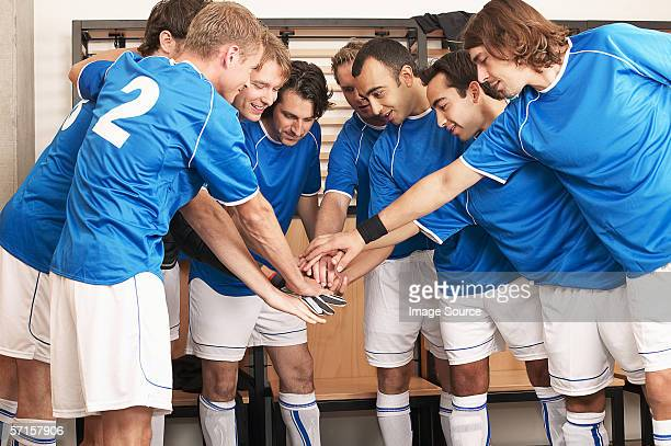 Football team putting hands together