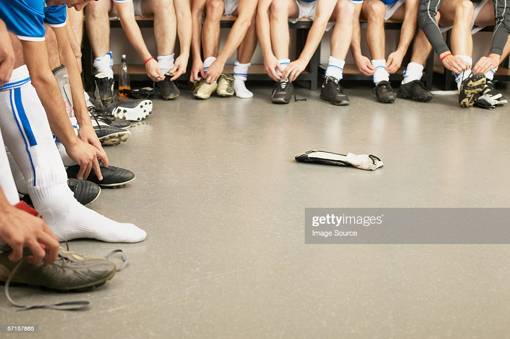 Football team tying laces : Stock Photo