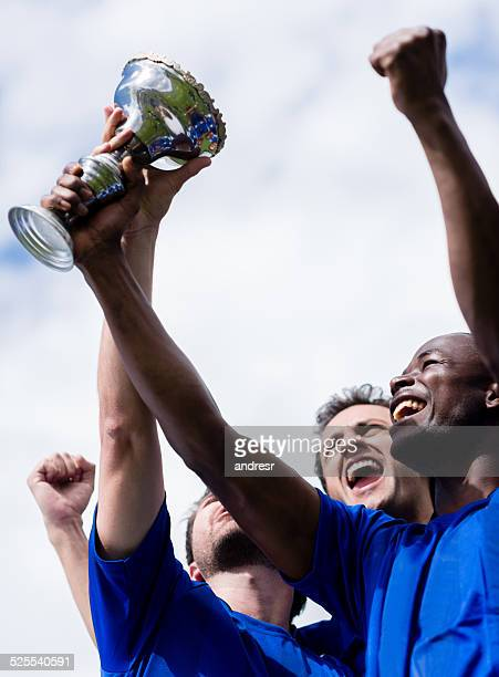 Football team winning the cup