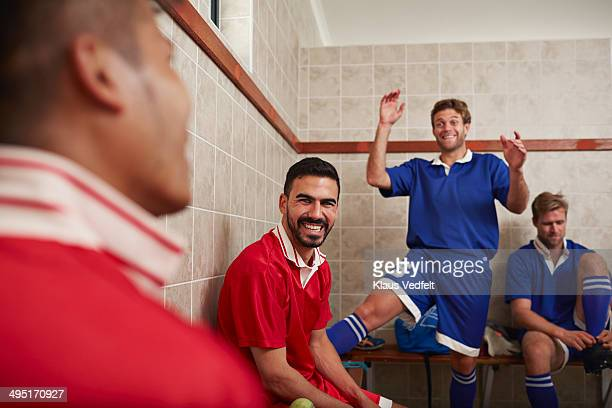 Football teammates laughing in changing room