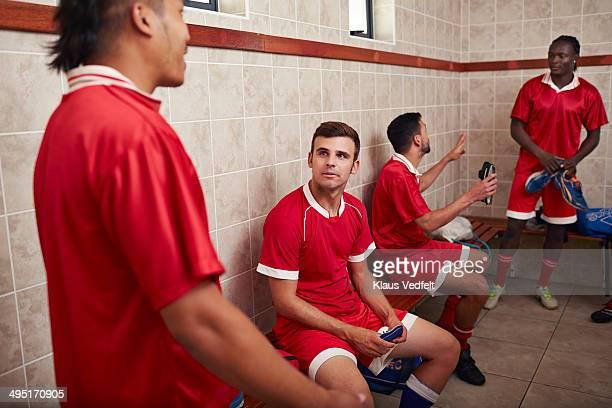 Football teammates talking in changing room