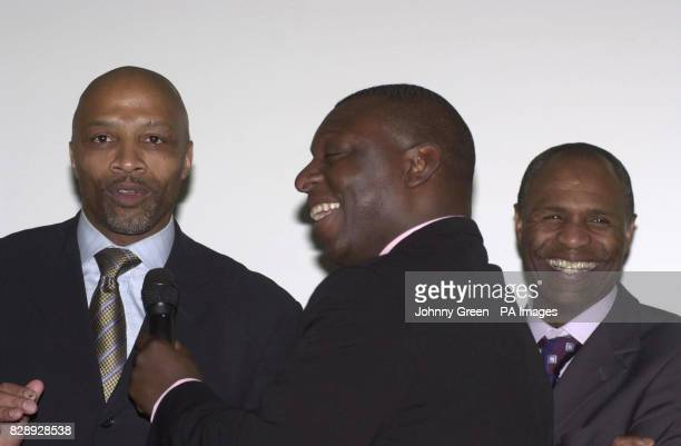 Football television presenter Garth Crooks talks to exfootballers Cyrille Regis and Luther Blissett during a reception in support of Kick Racism Out...
