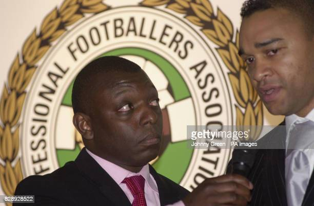 Football television presenter Garth Crooks talks to football pundit Paul Elliott during a reception in support of Kick Racism Out of Football held at...