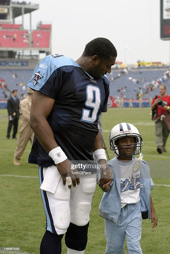Tennessee Titans QB Steve McNair walking off field with son Tyler after winning game vs Jacksonville Jaguars at The Coliseum Nashville TN CREDIT Tom...