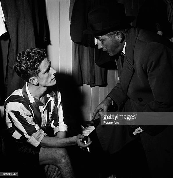 Football Tottenham Hotspur player Tommy Harmer chats in the dressing room at White Hart Lane with manager Arthur Rowe