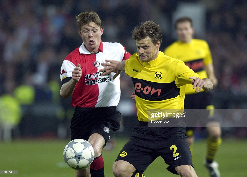 Football UEFA Cup Final Rotterdam Holland 8th May 2002 Feyenoord 3 v Borussia Dortmund 2 Feyenoord's Jon Dahl Tomasson with Dortmund's Christian Worns