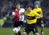 Football UEFA Cup Final Rotterdam Holland 8th May 2002 Feyenoord 3 v Borussia Dortmund 2 Feyenoord's Jon Dahl Tomasson with Dortmund's Christian Worns
