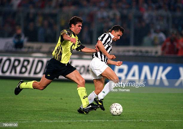 Football UEFA Cup Final Second Leg Turin Italy 19th May 1993 Juventus 3 v Borussia Dortmund 0 Roberto Baggio of Juventus is chased by Borussia...