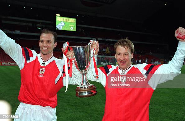 Football UEFA Cup Winners Cup Final Copenhagen Denmark 4th May 1994 Arsenal 1 v Parma 0 Arsenal's Steve Bould and Paul Merson hold the trophy aloft