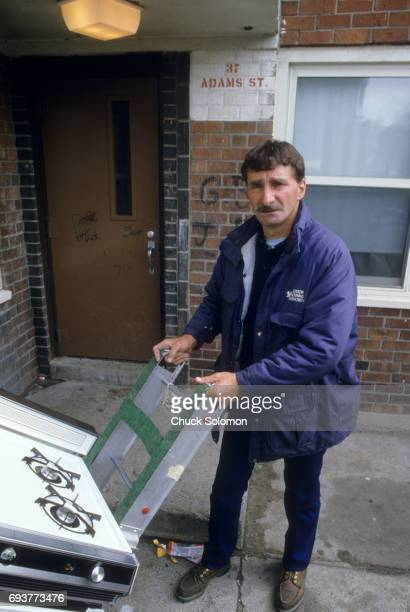 View of Howie Long Sr father of Los Angeles Raiders Howie Long holding handtruck at his job as supervisor of the Boston Housing Authority Boston MA...