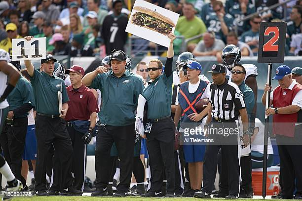 View of Philadelphia Eagles assistant coach on sidelines flashing cheesesteak card during game vs San Diego Chargers at Lincoln Financial Field...