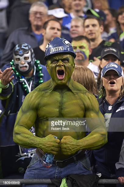 View of Seattle Seahawks fan with face and body painted as Incredible Hulk during game vs San Francisco 49ers at CenturyLink Field The crowd noise...