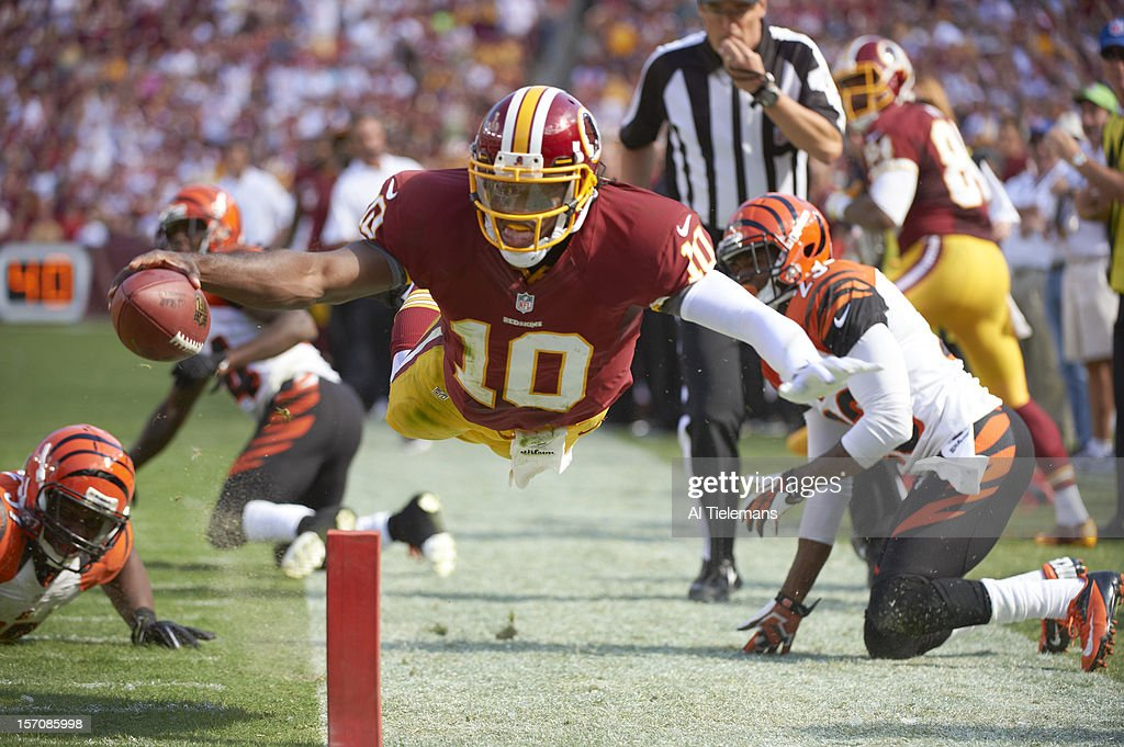 Washington Redskins QB Robert Griffin III in action diving towards endzone vs Cincinnati Bengals at FedEx Field No TD Griffin stepped out of bounds...