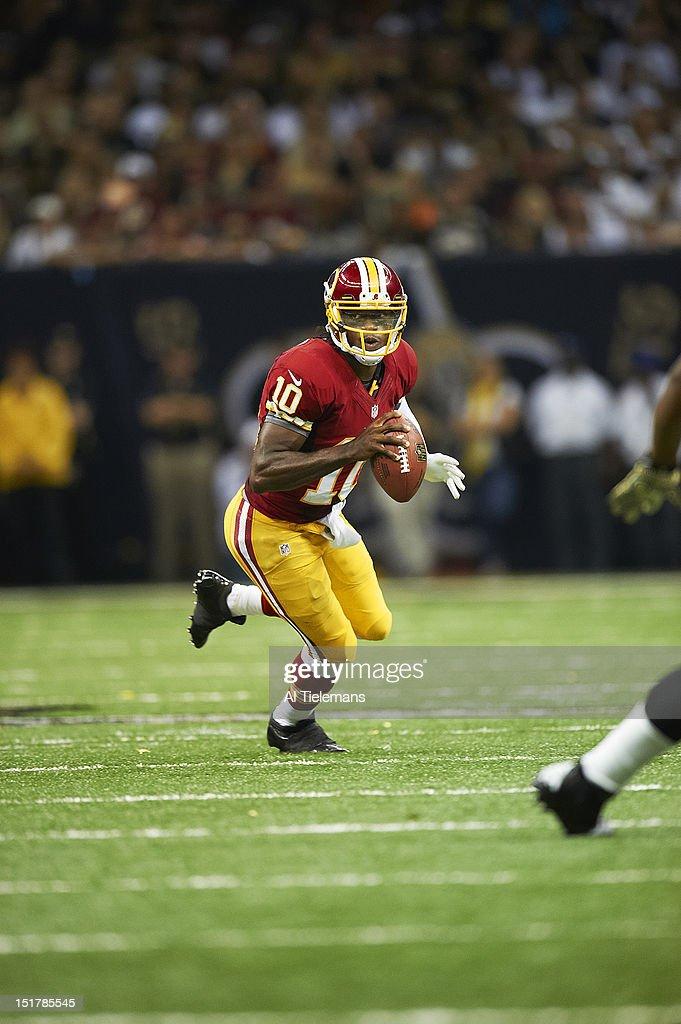 Washington Redskins QB Robert Griffin III (10) in action vs New Orleans Saints at Mercedes Benz Superdome. Cover. Al Tielemans F425 )