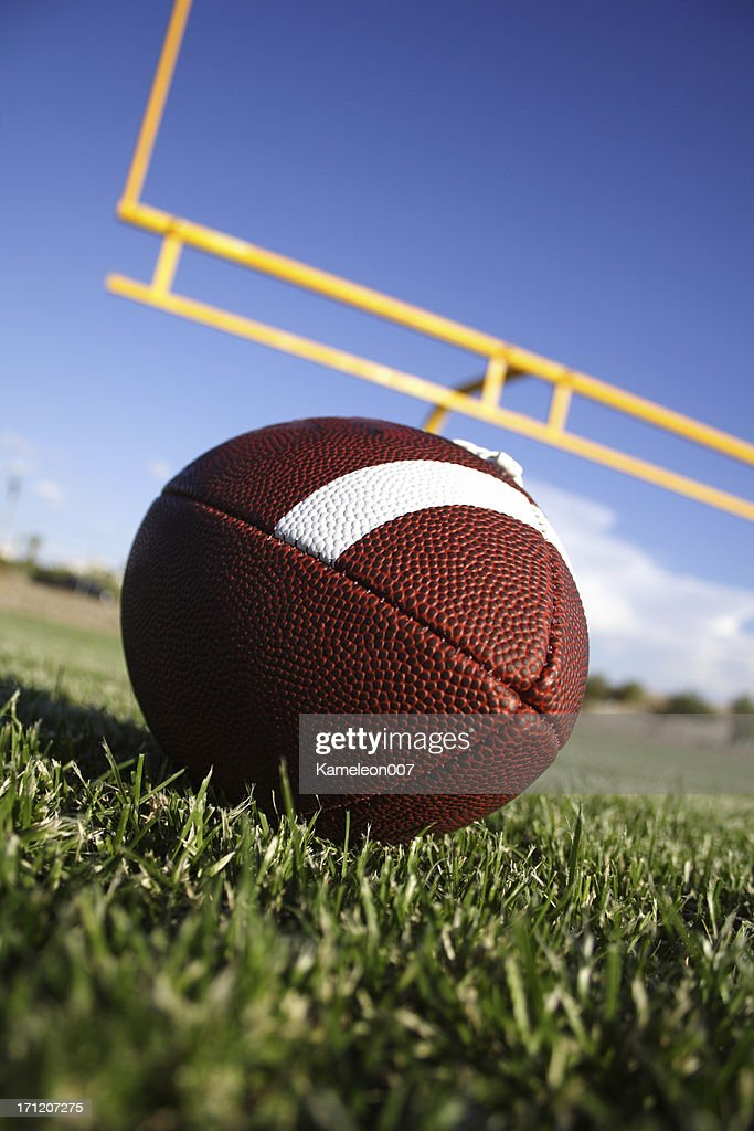 Football with fieldgoal on the background : Stock Photo