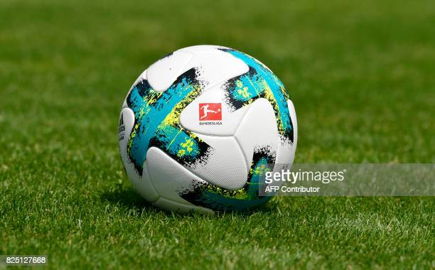 A football with the logo of the German first division football league Bundesliga is displayed during a team presentation of the German first division...