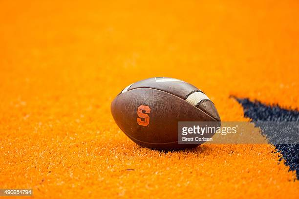 A football with the Syracuse Orange logo sets on the field before the game against the LSU Tigers on September 26 2015 at The Carrier Dome in...