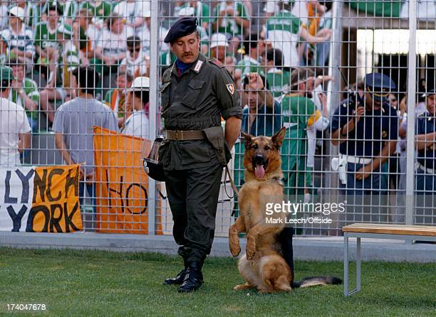 Football World Cup 1990 Egypt v Eire a policeman stands with his dog