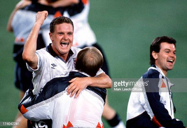 Football World Cup 1990 England v Belgium Paul Gascoigne celebrates by leaping into the arms of Steve McMahon after taking the free kick that led to...