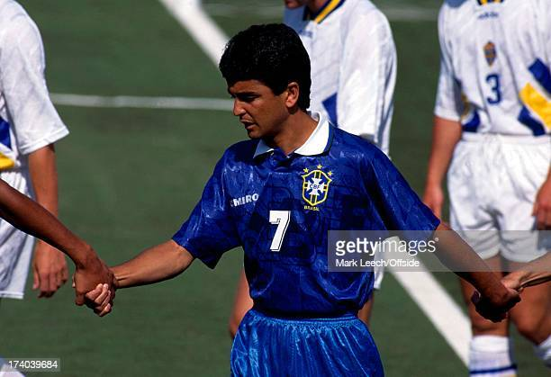 Football World Cup 1994 Brazil v Sweden Bebeto holds hands with his team mates as they enter the field
