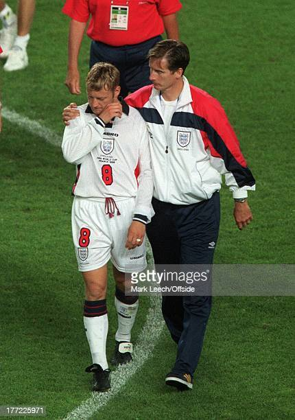 Football World Cup 1998 Argentina v England David Batty is consoled by Glenn Roeder after missing a penalty in the shootout