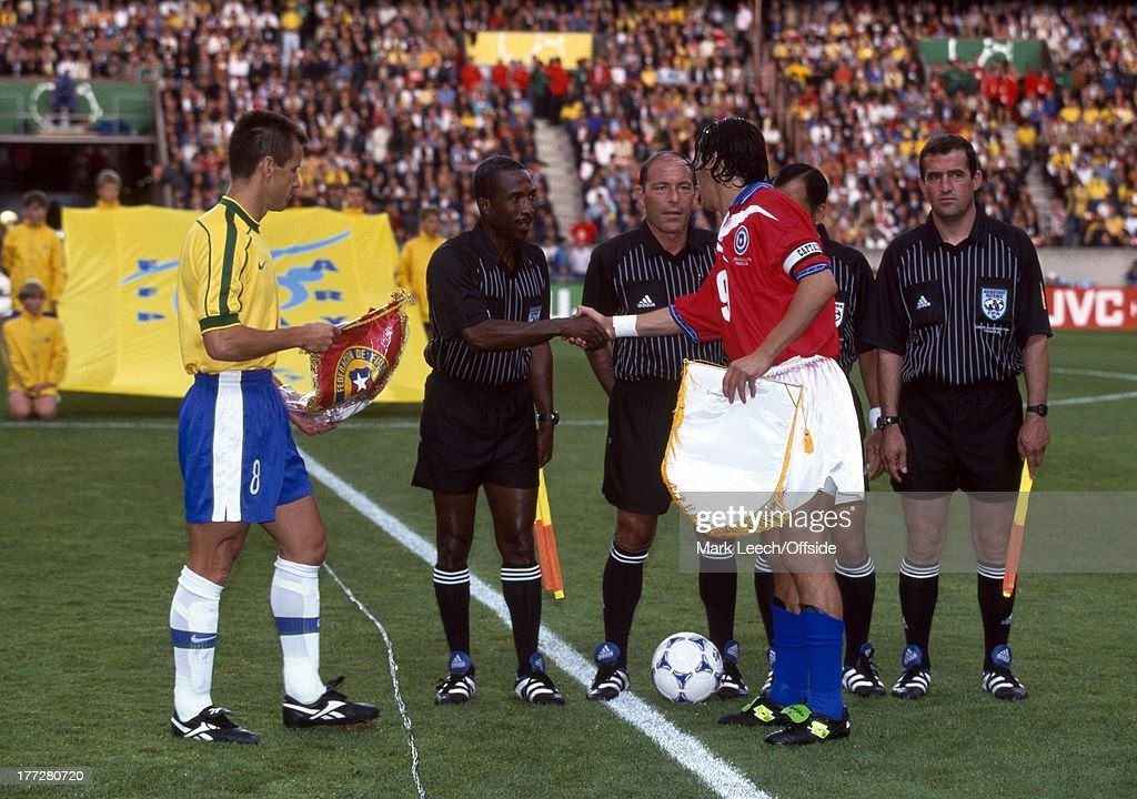 Football World Cup 1998 Brazil v Chile Team captain Dunga and Ivan Zamorano exchange pennants and shake hands with the officials