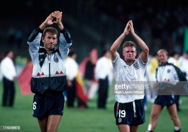 Football World Cup SemiFinal England v West Germany A tearful Paul Gascoigne applauds the England fans alongside Terry Butcher after England were...