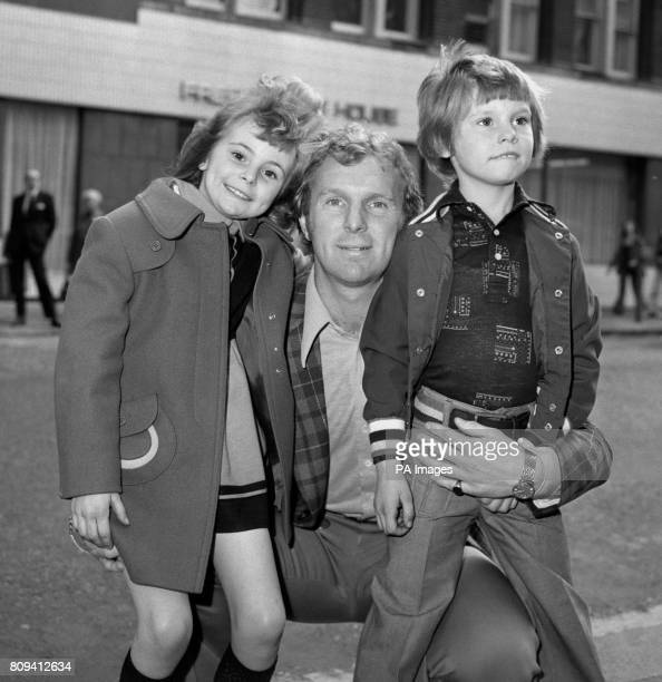 Football World Cup winning Captain Bobby Moore with his children Roberta and Dean at the children's matinee premiere of the film 'Swallows and...