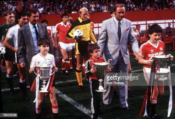 Football Young mascots bring out the trophies won by Aberdeen FC and Manchester United in 1983 prior to the testimonial match for United defender...