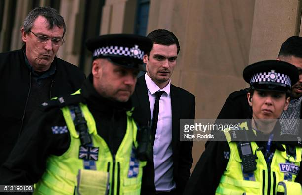 Footballer Adam Johnson leaves with his father Dave from Bradford Crown Court during day thirteen of the trial where he is facing child sexual...