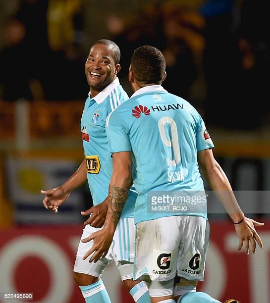 Footballer Alberto Rodriguez of Peru's team Sporting Cristal celebrates with teammate Santiago Silva after scoring against Uruguay's Penarol during...