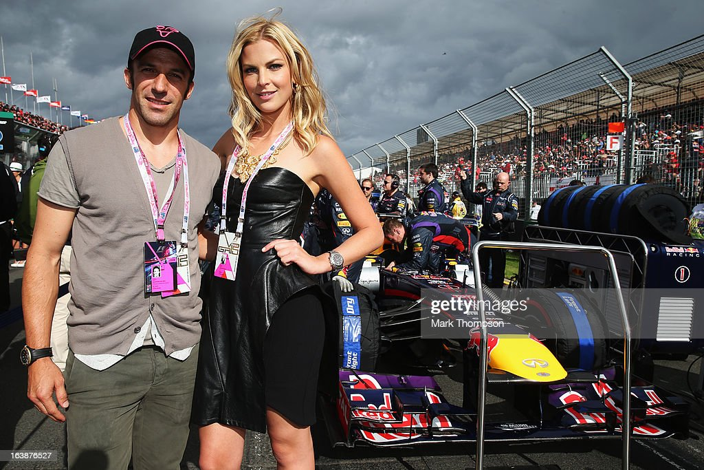 Footballer Alessandro Del Piero and model Chelsea Scanlan are seen by the car of Sebastian Vettel of Germany and Infiniti Red Bull Racing on the grid before the Australian Formula One Grand Prix at the Albert Park Circuit on March 17, 2013 in Melbourne, Australia.