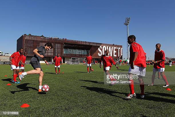 Footballer Alexandre Pato joins NIKE to celebrate the completion of the new NIKE community football training centre in Soweto on June 9 2010 in...
