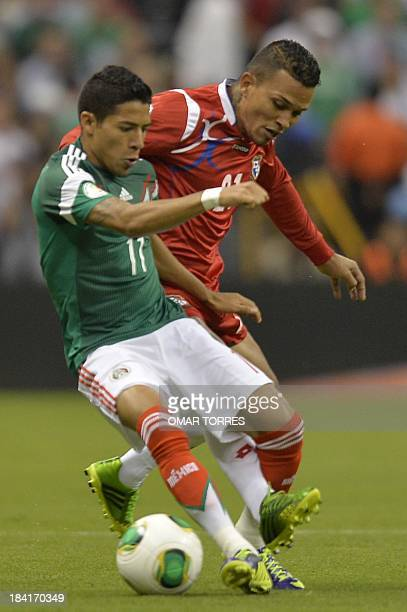Footballer Amilcar Henriquez of Panama and Javier Aquino of Mexico vie during their Brazil 2014 FIFA World Cup CONCACAF qualifier match at the Azteca...