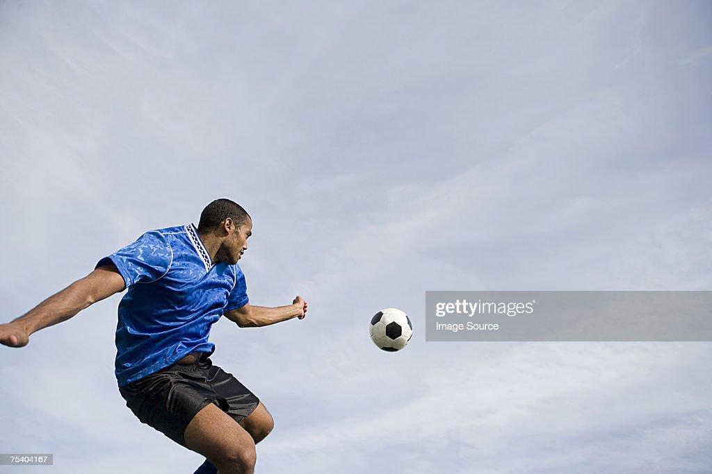 Footballer and ball : Stock Photo