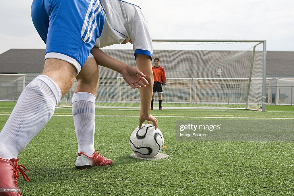 Footballer and goalkeeper : Stock Photo