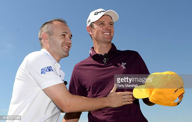 Footballer Andres Iniesta of Spain poses with Justin Rose of England during The Costa Smeralda Invitational Golf Tournament at Pevero Golf Club Costa...